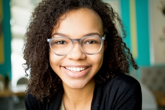 Cheerful African American student wearing glasses