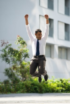 Cheerful Businessman Jumping Celebrating Success