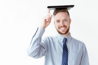 Cheerful businessman with leather folder on head