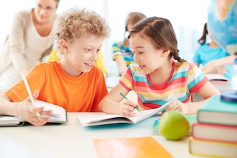 Cheerful classmates chatting