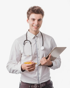 Cheerful doctor with tablet and pen