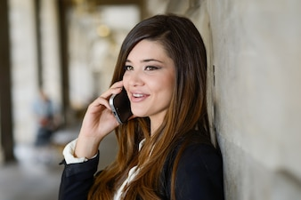 Cheerful employee while talking on phone