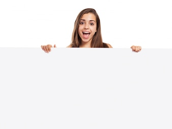 Cheerful girl holding a blank poster