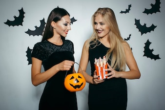 Cheerful girls with Halloween decorations