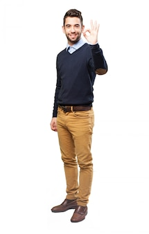 Cheerful guy gesturing with his left hand