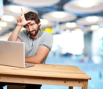 Cheerful guy working with laptop