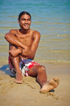 Cheerful man enjoying the beach
