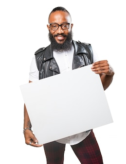 Cheerful man showing a sign over white background