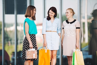 Cheerful pretty women with purchases