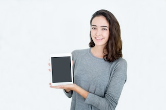 Cheerful successful businesswoman showing tablet