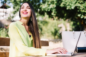 Cheerful woman at laptop