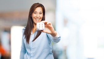 Cheerful woman showing a dice