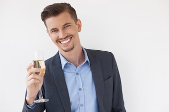 Cheerful Young Entrepreneur Raising Glass of Wine
