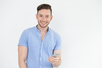Cheerful young male manager with gadget