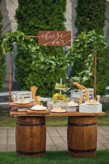 Cheese bar put on two wooden barrels