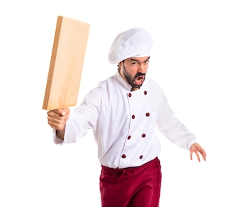 Chef attacking with kitchen tool