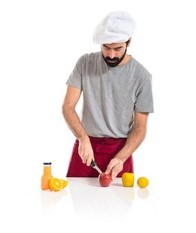 Chef cutting an apple