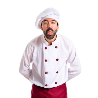 Chef doing a joke over white background