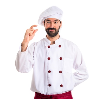 Chef doing tiny sign over white background