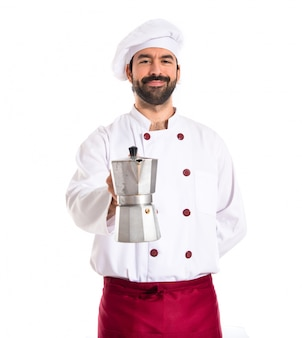 Chef holding coffe pot