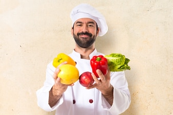 Chef holding vegetables