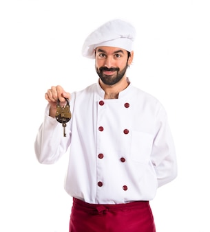 Chef holding vintage padlock over white background