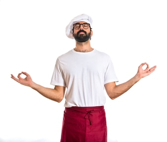 Chef in zen position over white background