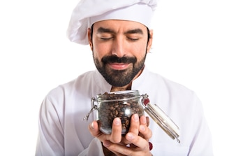 Chef smelling coffee beans