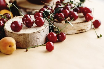 Cherries on wooden stumps