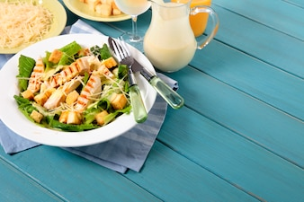 Chicken caesar salad on picnic table