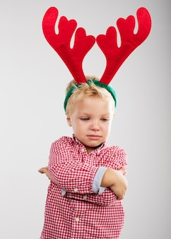 Child angry with reindeer antlers