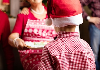 Child back with santa claus hat