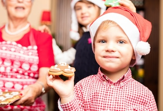 Child eating christmas cookies