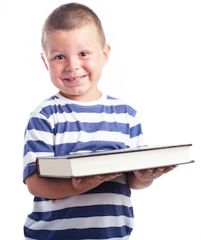 Child holding a very large book