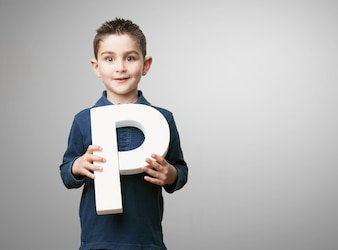 Child holding the letter  p