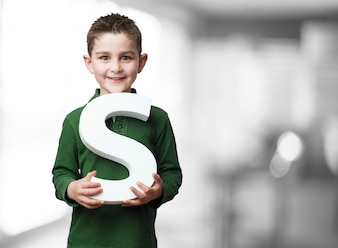 Child holding the letter  s