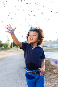 Child pulling confetti