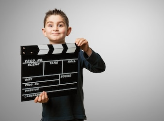 Child with a movie clapboard