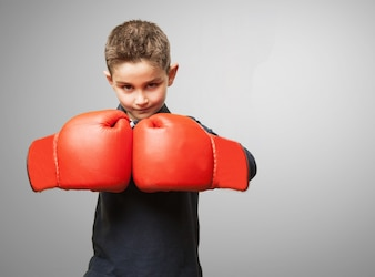 Child with red boxing gloves