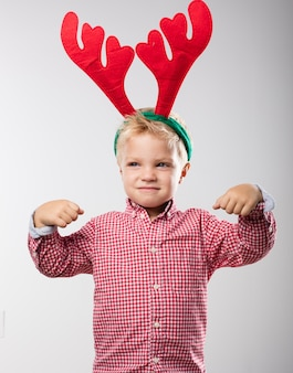 Child with reindeer antlers