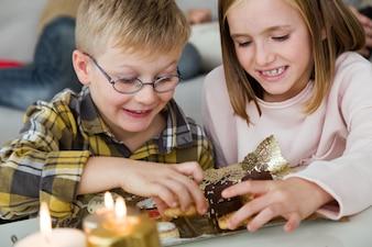 Children eating homemade sweets