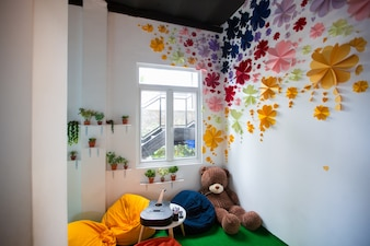 Childrens room with handmade flowers on walls