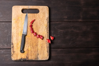 Chilli and knife with chopping block