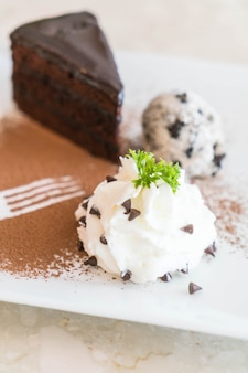 Chocolate cake with ice-cream and whipped cream