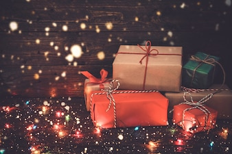 Christmas background - Christmas present gifts box and snow on old wooden background. vintage color tone