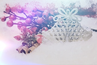 Christmas background with cinammon berries and snowflakes