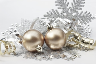 Christmas background with decorations in gold and silver