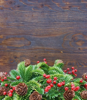 Christmas background with garland against a wooden background