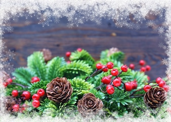 Christmas background with pinecone and mistletoe
