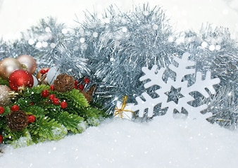 Christmas background with snowflakes and natural elements